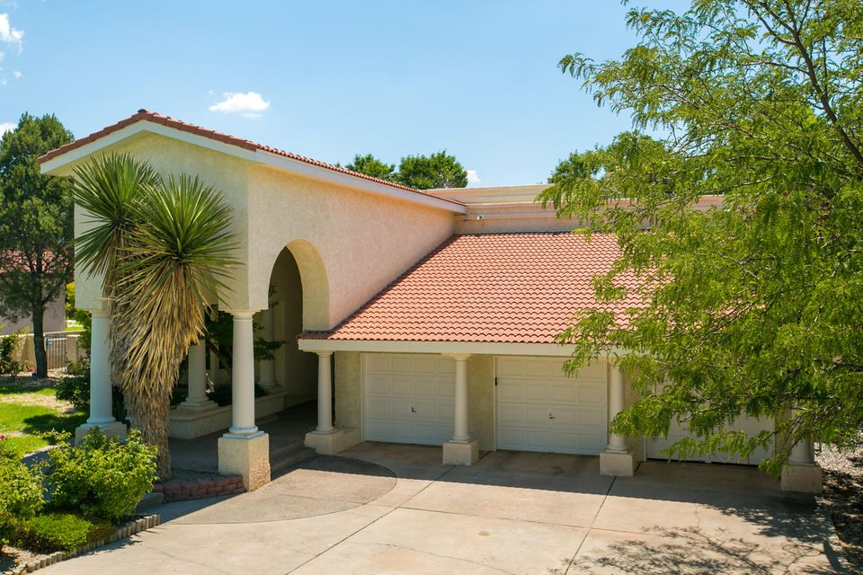 This Beautiful Tanoan Home is right on the Golf Course! Enjoy the views from the second story large Master Bedroom balcony Zia 6. Formal and family dinning. Two large living areas, Two large covered balconies. Views! Large bedroom or office on main level.Beautiful pool.