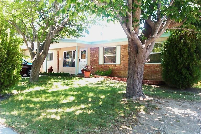 One of Albuquerque Northeast Heights 4 Bedroom Homes for Sale at 11112 NE Woodland Avenue