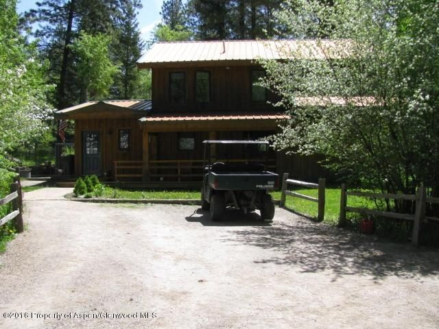 Edge of Marble on one acre.  Easy access of County Rd 3.  Aspen and pine covered lot with great views! Nicely finished 3BR, 2BTH hone with metal roof and cedar siding. Interior includes oak hardwood flooring throughout with granite counters in kitchen and baths, large master suite with huge walk-in closet. Heated workshop in rear of the home,  covered front porch and a large patio area for entertaining outside.  Area for possible ADU in rear and utilities run to the area. Dog pen included. Insulated foam panel construction keeps utility bills lower. Electric high +/-$250 and low of $60.