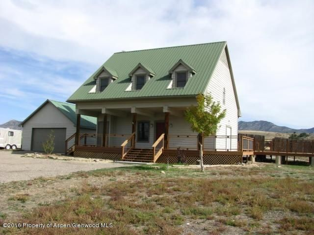 Totally remodeled ranch house, new kitchen, baths, flooring and decks. Beautiful valley views from this 39 acres with irrigation (Rifle Canyon Ditch), totally fenced and also has 2 car garage, corrals, calving sheds and agricultural bldgs. As a bonus, there is a large shop (891 sq ft) and two studio apartments (462sf and 656sf) that rent for approx. $1410/mo total.Domestic well with 2000 gal cistern for additional storage.