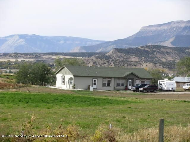 """UBC/IRC modular home on 6.66 acres.  Great views in all directions and lots of sunshine, with very few neighbors. Home is in excellent condition, bright, open floor plan and lots of windows large living area and large kitchen and a huge master suite.  Shared well with adjacent home and irrigation water to run 2 hose bibs during irrigation season. Property includes 50% of the minerals (which is all seller owns). Property is leased until June 30, 2017 at $1685/mo.Can be purchased as a package with MLS #146408 and #146411 at a reduced price. <a href=http://www.listingsmagic.com/146804"""" target=""""_blank""""><b>Click here for Virtual Tour</b></a>"""