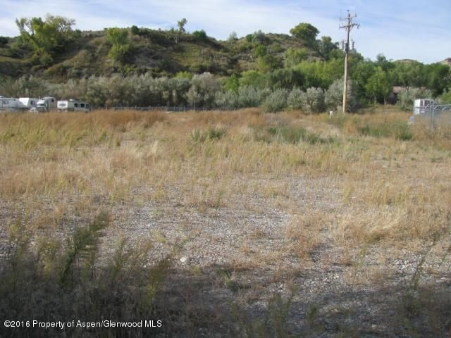 EXCELLENT INDUSTRIAL LOCATION EAST OF RIFLE!  1.8 flat completely usable acres. Perimeter is fenced with 6 ft chain link, property is completely graveled. Storage box type trailer included, sold as-is where-is.  Owner will consider financing for qualified buyer.Property may also be leased, see MLS# 146496