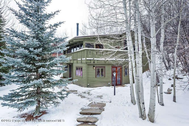 This unique home is located in the quiet east side of town. Featuring 4 bedrooms and 4 baths, This home features privacy and unhampered views of Independence Pass and the North Star Preserve. Natural gardens,mature landscaping and water feature. Shuttle to downtown Aspen which is just 1 mile away or enjoy a beautiful walk or bike ride.