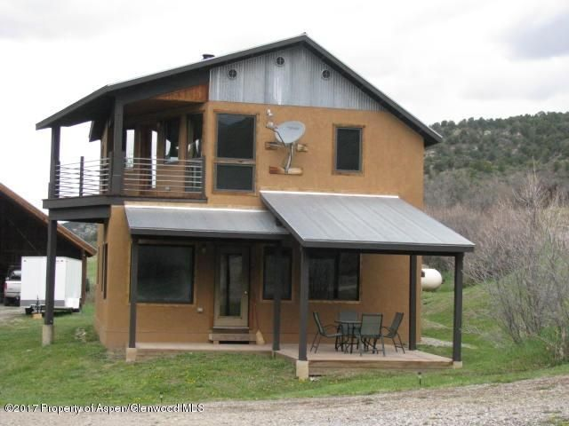 YEAR ROUND ACCESS VIA COUNTY ROAD TO THIS EAST DIVIDE RESIDENCE OR GETAWAY PROPERTY! BORDERS BLM LAND ON NORTH AND SOUTH SIDES!  Stucco home on 40 acres with East Divide Creek just steps away form the house. Off the grid with excellent solar system and booster for cell phones.  Historical irrigation water for approx. 8 acres. Seller's 50% of minerals is included in the sale Excellent access for hunting, snowmobiling, biking, hiking, horseback riding or whatever.  Privacy on the creek! Great year round getaway or hunting lodge or both.  2BR plus 3rd non-conforming BR without closet, ample kitchen and living area. Adjacent 40 acre property (same owner)with large equipment shed available at an additional cost and goes very well with this 40 acre property.
