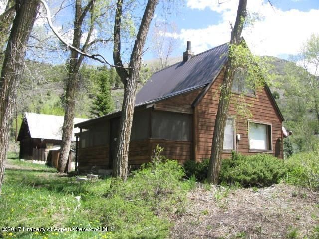 Great little place in Marble for full time residence or cabin getaway. Large main bedroom and 2 small bedrooms upstairs (access thru small door in living room). Kitchen area with a great wood cook stove as well as propane. Screened in porch and lots of mature trees and privacy. Property abuts Beaver Lake Lodge Property. Property is on Marble Water Company Water and septic. Old well and pumphouse on property, seller has no knowledge about. One car garage with upstairs storage area. Property being sold furnished, everything stays unless negotiated differently at contract. Will be surveyed soon, acreage may change slightly. Upstairs bedrooms may no longer meet code.