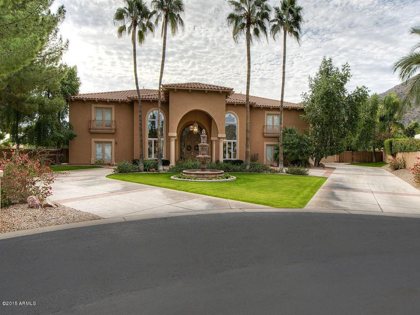 Fire sale  pricing in Finnisterre!  11,000 + sqft situated on a wonderful lot in one of Paradise Valley's most prestigious communities. This estate boosts 6 bedrooms and 8.5 baths. A spectacular two-story dual stair case. Gorgeous great room with an entertaining social bar and cozy fireplace. Mater retreat will provide intimacy and breathtaking views of Camelback Mountain.  Guest and family will be able to relax in comfort with a 3,000 sq ft attached guest casita   Backyard captures view with a beautiful pool, sport court and room for much much more!  This home is at an unheard of price .  A true opportunity.