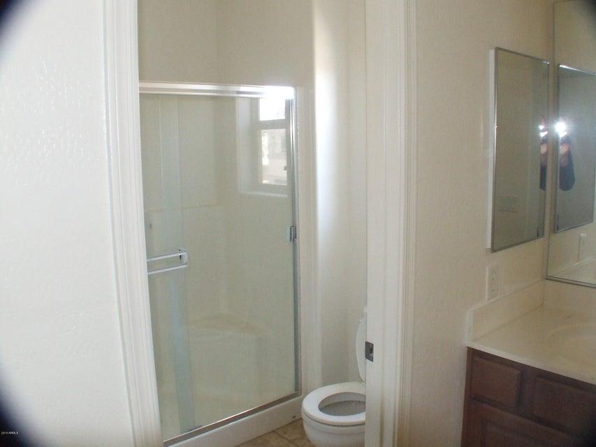 MLS 5595492 706 W BALDWIN Loop, Coolidge, AZ 85128 Coolidge AZ Four Bedroom