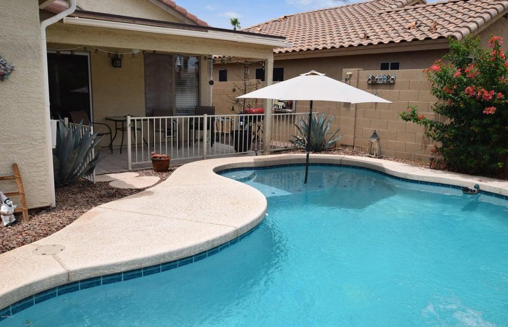 MLS 5793876 15037 W BOTTLE TREE Avenue, Surprise, AZ Surprise AZ Private Pool