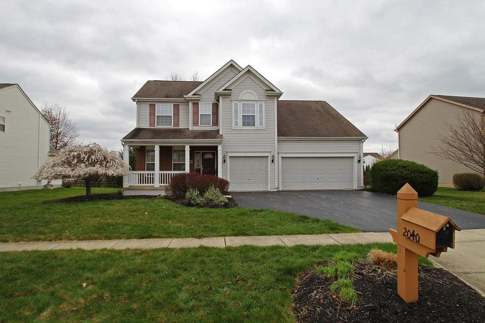 Photo of home for sale at 2040 Alum Village Drive, Lewis Center OH