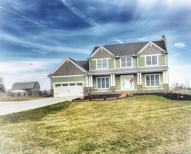 Photo of home for sale at 11874 Saddlebrook Drive NW, Baltimore OH