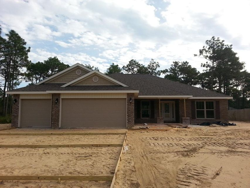 Photo of home for sale at 7807 Fenwick, Navarre FL