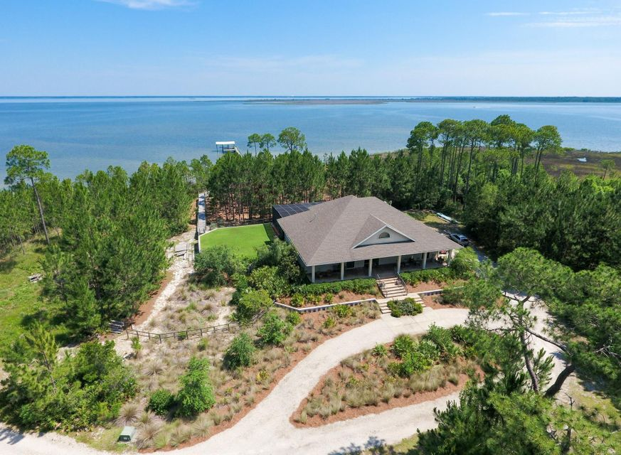 "You'll love this stunning 2-story home with an open floor plan and breathtaking views of Choctawhatchee Bay! This 4-bedroom, 4-bathroom home with a 2-car garage will give you just over 4,400 sq. ft. of luxurious space to enjoy. This home screams charm from the moment you enter the circular driveway overlooking a stocked pond and walk up to the porch stretching the entire length of the front of the house. Spend your mornings walking out on the 250 ft. dock (with electricity, water & lift) to take in the sunrise and your afternoons lounging by the screened-in, Bay front, salt water pool situated in the generous outdoor space. This is a phenomenal private lot totaling 3.38 acres of pure serenity with 240 ft. of Bay frontage. There is a fenced backyard bordering natural pines down to the Bay! The inside of the home features glass sliders & large Pella windows bringing the peaceful feel of the outdoors in. Some of the many touches showcased downstairs are solid wood cabinets, 20"" porcelain tile floors, and 10' ceilings. You'll enjoy entertaining in the gorgeous professional kitchen with a wet bar and a temperature controlled wine room big enough to hold over 1000 bottles of wine.  The master suite is pure luxury with a large bay window, sitting area, large tub, separate shower, and 2 walk-in closets. The east side 1st floor bedroom provides a second master with an entry to the patio. Walk up the oak staircase to find two additional bedrooms, each with access to a large balcony, a bonus room, a full bath, and a generous amount of storage.    The bells and whistles in this incredible home carry all the way down to the 2-car garage where you will find space for a workshop as well as a piece of a wall painting by world famous artist Robert Wyland. In addition, this home is equipped with hurricane protection, 2 HVAC systems, a whole-house generator, a zoned irrigation system with auto-timer, 2 gas water heaters, an alarm system, surround sound, large laundry room with sinks and workspace, and fruit trees in the yard. There is no HOA. Property Taxes for 2015 were $4855. Be sure to look at the attached Cost to Own that shows the overall expenses. Do not miss out on this incredible opportunity to own a private oasis on the Bay!"