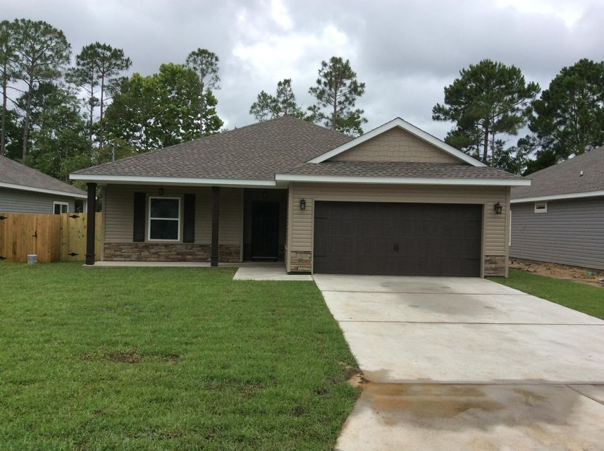 Photo of home for sale at 2271 Tom, Navarre FL