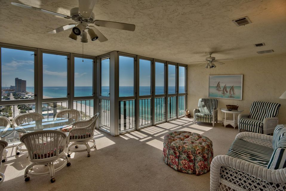 Incredible opportunity to own one of the largest Gulf front units on the coastline! Regency Towers Unit 1414 is a beautiful penthouse offering a total of 3,224 square feet, including the 572 sq. ft. enclosed balcony (h&c). This was originally one condominium, but has been combined with another unit and converted into a spectacular space that is sure to impress. This is a 3-bedroom, 3-bath unit offering a large living area, expansive enclosed balcony with incredible Gulf views and an open floor plan with raised ceilings and thick crown molding. The unit is being sold fully furnished and the decor was recently updated for a coastal look. The kitchen and dining area is very spacious and open with wood flooring, classic columns, ample cabinets and a island with seating for more casual dining.