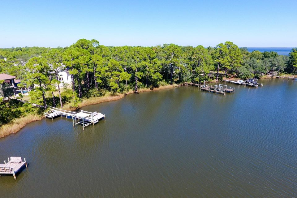 Beautiful waterfront lot in the gated community of Botany Bayou. There is a great dock with boat and jet ski lifts ready for you to enjoy the benefits of the bay. This phenomenal lot has approximately 105 feet of water frontage and is about 320 feet deep, totaling about .76 acres. The 3/4 acre lot is situated on a bayou and is in close proximity to the bay. Prime location and just a short distance to the beautiful white sand beaches and emerald green waters of the Gulf of Mexico. Build your dream home and start living the coastal lifestyle!