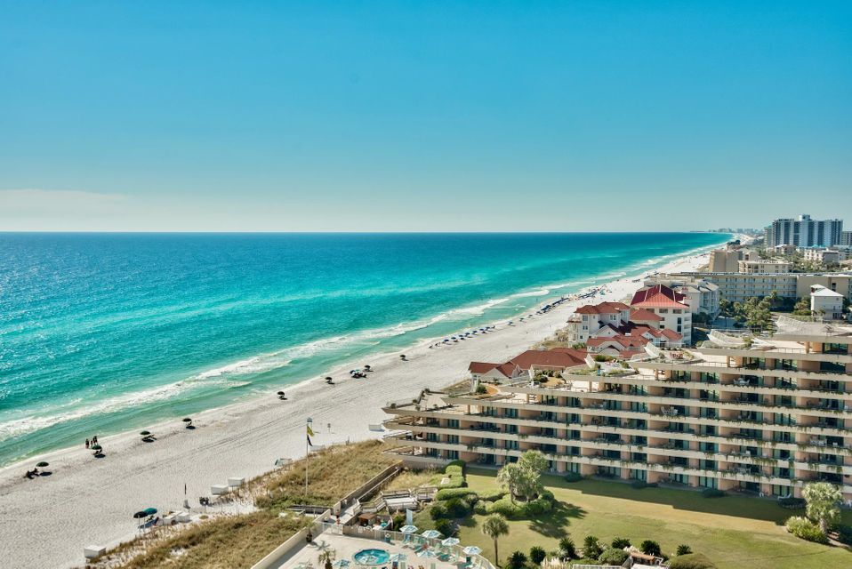 You truly feel like you are on top of the world the minute you step off of the private elevator that opens directly into your unit. This unit has two Gulf front master suites, a huge Gulf front balcony and incredible direct Gulf front views of the emerald coast and white sand beaches everywhere you look. Unit 1130 is facing West which allows you to see breathtaking sunsets every evening and gives you views down the entire beach to the Destin Pass. You will truly be amazed by the craftsmanship and attention to detail that this luxurious unit offers. It is a spectacular 3-bedroom, 3-bath fully furnished unit with panoramic views and upscale features throughout. The large, tiled, wrap around balcony has a built-in gas stainless grill and is perfect for entertaining or simply relaxing. This spacious unit has floor to ceiling glass windows and doors to maximize the views, raised ceilings with crown molding & recessed lighting and polished travertine flooring tiled on the diagonal throughout except bedrooms. The unit is wired for surround sound and features trayed ceilings for a dramatic effect. There is an exquisite open kitchen with top-of-the-line stainless appliances, gas range, custom cabinets, thick granite countertops & island with pedestal lights and seating for casual dining. There is an additional dining area for six that merges right into the spacious living area.   Master suite has direct balcony access, large walk-in closet and a stunning bathroom with granite countertops, custom cabinets, large mirrors with vanity area, walk-in shower and separate Whirlpool tub for two. There is an additional master suite that is also Gulf front with an en-suite bathroom. There is a third guest bedroom and bathroom and a spacious laundry room.   Grand Dunes is a secured, gated resort and amenities include private high speed elevators that open directly into foyer of your unit, private beach, large Gulf front lagoon pool surrounded by Palm tress with a cascading waterfall, a private second pool for the north tower, grand lobby, tennis, ample underground parking, Gulf front exercise room, private owners' lounge, conference room, billiard area, and 2 suites for overflow guests. Don't miss out on your opportunity to live at South Walton's finest high rise development.   Grand Dunes amenities include private beach, gated entry, tennis courts, Gulf front exercise room, private conference room and even two suites for overflow guests. The pool area is sure to impress with a Gulf front lagoon pool, additional pool (heated seasonally), hot tub, gazebo and sun deck all surrounded by lush landscaping, water features and walkways along the pool lined with palm trees. Relax at the pool and enjoy the luxury all in a tropical setting to stunning views of the Gulf of Mexico. There is a boardwalk to a deeded beach with seasonal beach service. Additional amenities include tri-level secure parking, private high speed elevators & much more. This is an incredible location along Scenic 98 next to many conveniences, shopping, grocery store, dining & entertainment and Silver Shells Outlet Center. Don't miss out on your opportunity to live at South Walton's finest high rise development.