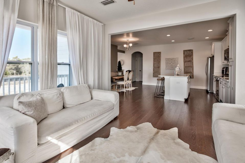 Phenomenal 4-bedroom, 3-bath home with Gulf views in Inlet Heights with beautiful finishes throughout. This home has a fantastic location close to the Gulf of Mexico and Inlet beach access - great for a full time residence, second home or vacation rental. The popular 30Avenue is nearby with many dining, entertainment and shopping options as well as prestigious communities like Rosemary & Alys Beach. Great curb appeal with the paver stone driveway and welcoming brick archway. Home features a 1-car garage and beautiful hardwood flooring throughout the home. The kitchen is breathtaking with beautiful Quartz countertops, stainless steel appliances and contemporary shaker cabinets. The kitchen is open to the dining & living area making this home great for entertaining. There is a nice covered porch off the living & dining area to relax and enjoy the Gulf views. The second level also offers a guest bedroom and bathroom. The first level has two spacious bedrooms which is a nice convenience along with a shared bathroom with granite countertops with tiled walk-in shower. There is a phenomenal master suite that encompasses the entire third floor and is sure to impress! The master suite features a trayed ceiling with crown molding and is an incredible size totaling 29 x 24 feet. There is a great sitting area within the master with large windows bringing the outside in along with Gulf views. This area could be perfect for an office as well. The master offers a walk-in closet and en-suite bathrooms with granite, double vanities and tiled walk-in shower. This floor is a true retreat! The home is a great investment and the popular 'San Clemente' floor plan from Holiday Builders. The home features an 8-year builder warranty on the structure and has low expenses - see the cost to own attached. Own near 30A for half the cost!