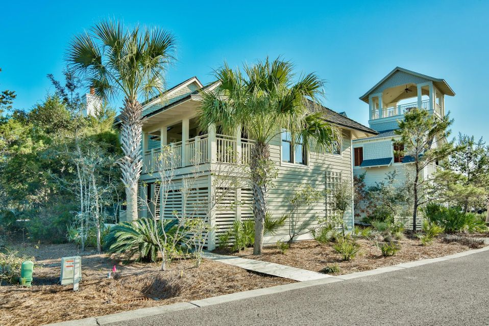 Phenomenal opportunity to own the best priced home within WaterSound Bridges! Private and serene setting just 200 ft. from the breathtaking boardwalk to the beach. Surrounded by ultra luxury homes and a natural environment, this location stands apart from the rest. The accessibility to amenities is superb with a manicured green space bordering the left side of the home and a fantastic pool & sun deck next to that. A pond and walkway is directly across the street from the front of the home and the rear boasts permanent views of Camp Creek Lake, rare coastal dunes and the emerald green waters of the Gulf of Mexico. This is a stunning custom built 4-bedroom home & 1br carriage home designed by Tom Christ that is being sold fully furnished and beautifully decorated with inviting coastal decor! The home is complete with a 2-car garage with guest quarters above including a beautiful granite kitchen and ensuite bathroom. There is an additional storage closet below that is the perfect size to store bikes to enjoy the area with. The main home features a first and second floor master suite making this home perfect for large families. It would make a great rental property or full time residence. Currently the home is a non-rental and is very well maintained. Attention to detail is apparent and every nook of the home has been thought out. Even upon entry by the stairwell there is a lounge area and small wet bar including a sink, wine fridge and ice maker. Stunning hardwood flooring extends throughout the home with beautiful tile and granite in the bathrooms. The lower level master is fantastic with a private screened-in porch offering secluded, wooded views of the park and there is a stairwell that leads to the upper level balcony where you can take in the Gulf views. This master has a walk-in closet and en-suite bathroom with large soaking tub, separate shower and double vanity. There are two additional rooms downstairs each with ensuite bathrooms. One room offers two twin bed
