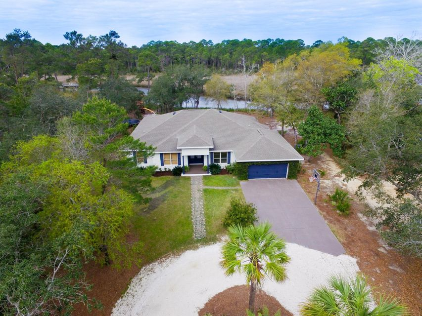 If you have been searching for a coastal paradise surrounded by nature where serenity is at your door step, this water front estate is calling your name.  From the minute you pull up to the entrance of this property you will realize that this property is unique. The home sits on a spacious water front lot providing a 100 ft of frontage that is just under an acre providing extreme privacy, yet you are conveniently located to multiple restaurants, the beach, and many other entertainment amenities.  Welcome to 109 West Hodge Rd. As you walk through the front door you will immediately realize the pride of ownership.  This single story 3BR / 2.5BA + large bonus room, waterfront estate on Mussett Bayou has custom finishes throughout and provides amazing indoor and outdoor entertainment space including a waterfront billiard room, spacious kitchen, living room, huge master bedroom all facing the water, incredible outdoor patio, fire pit next to the the bayou, gazebo, and much more. This truly is a place to get away from it all. You can only imagine the solitude of sitting around an outdoor evening fire pit along the water reflecting on the good times with family and friends under a star lit night. The best of all this is a boater's paradise with deep water year round where you are only a 10 minute boat ride to Baytowne Wharf in SanDestin Resorts and 30 minutes to Crab Island and the Destin Pass. Start enjoying the coastal lifestyle today. You owe it to yourself to see this property as it is sure to impress.