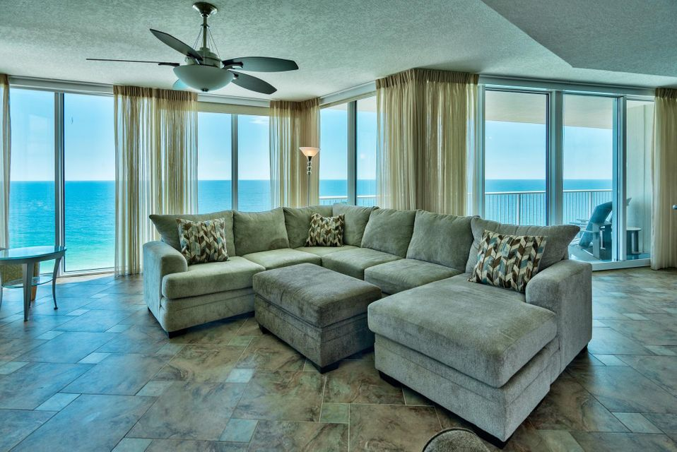 Have you been waiting for an updated corner unit at Palazzo with breathtaking views? Unit #1501 is an incredible 3-bedroom, 3-bath, Gulf front East corner unit that is being sold fully furnished and beautifully decorated with flat screen TVs. The entire corner as well as the front of the unit is nothing but floor to ceiling glass that maximize the views for a tremendous wow factor as you enter! The glass is high quality & UV tinted. Enjoy the spacious 229 ft. balcony with access from both the living area & master bedroom. Interior features an open floor plan totaling ~1,849 sq. ft., 9 ft. raised ceilings & crown molding. This home features beautiful custom tile floors, new custom curtains (nearly $7k value) and luxurious coastal decor. Pride of ownership is apparent the moment you step in! This unit is one of the best locations among the East corner units as it is a high enough floor to clear the neighboring property, lending unobstructed Gulf views throughout the living & dining area and kitchen. The open kitchen features thick granite countertops & breakfast bar, stainless steel appliances, cherry wood cabinets and recessed lighting. There is a pantry for additional storage. The kitchen is open to the dining & living area, making this an ideal entertainment space. The dining area seats six or enjoy casual dining at the granite breakfast bar.  The master bedroom is Gulf front with stunning views of the Gulf of Mexico by the surrounding floor to ceiling windows. There is direct access to the balcony, a walk-in closet and an en-suite bathroom to enjoy. The master bathroom features a double vanity, Whirlpool tub to relax in and separate walk-in shower. The master suite is separate from the guest bedrooms for privacy. There are two guest bedrooms, one with an en-suite bathroom with Gulf views. The additional guest bedroom is quite spacious with two full beds. This unit sleeps 8-10 guests and has a full size washer/dryer closet with storage and an owner's closet.   Palazzo amenities include a beautiful elevated Gulf front pool deck with a covered hot tub and pool heated seasonally to enjoy year round. There is a boardwalk and designated beach with complimentary beach service (Mar-Oct). Amenities also include a Gulf front fitness facility & conference room and a welcoming lobby. At Palazzo, you are on the desirable West End of Panama City Beach, just 1 mile from Pier Park shopping center and less than 20 minutes from the Panama City Beach International Airport. Unlike the competition, Palazzo is a low-density building consisting of only 129 direct Gulf Front units and has four levels of covered Gulf Front parking under the building - no need for massive parking garages with elevated walkways across the street. Do not miss out on this incredible opportunity to own a beautiful corner unit at one of the finest condominiums in Panama City Beach. Unit #1501 truly is the perfect second home, full-time residence or vacation rental and will not last long!