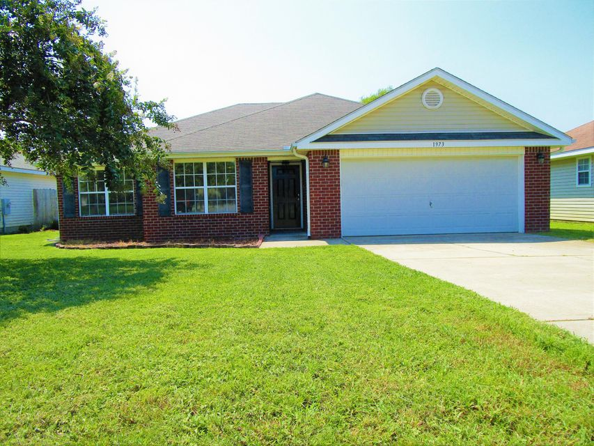 Photo of home for sale at 1973 Shadow Lake Dr, Gulf Breeze FL