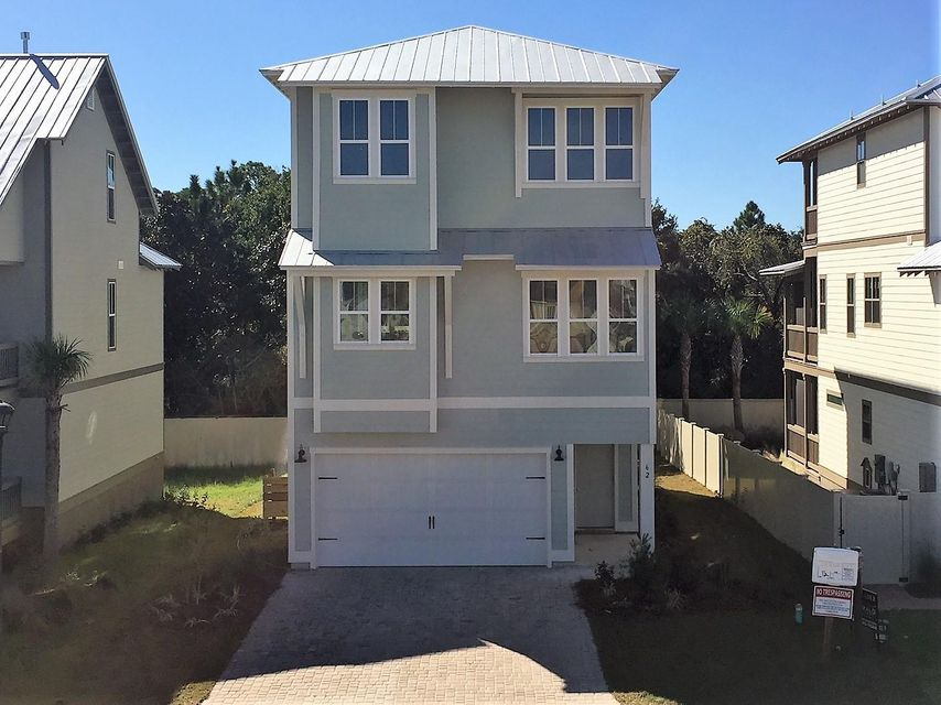 Photo of home for sale at 62 Grande Pointe Drive S, Inlet Beach FL