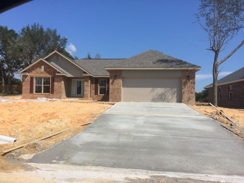 Photo of home for sale at 8462 Holley Hills Circle, Navarre FL