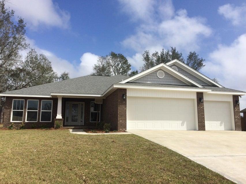 Photo of home for sale at 8703 Rio Vista, Navarre FL