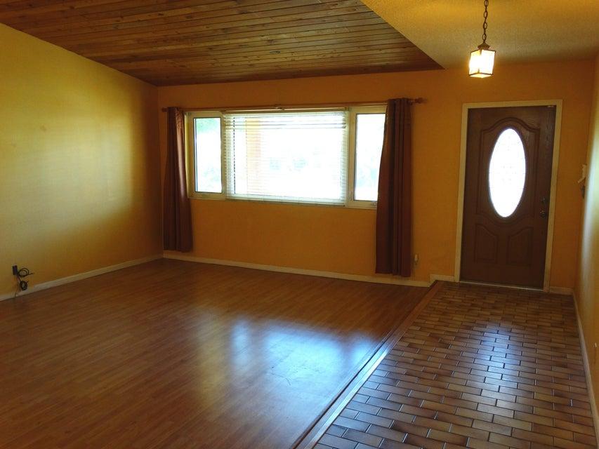 Sunken living room and front door