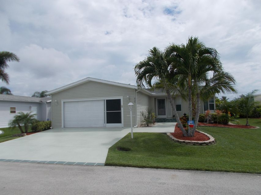 8175 13th Hole Drive , Port Saint Lucie FL 34952 is listed for sale as MLS Listing RX-10242439 36 photos