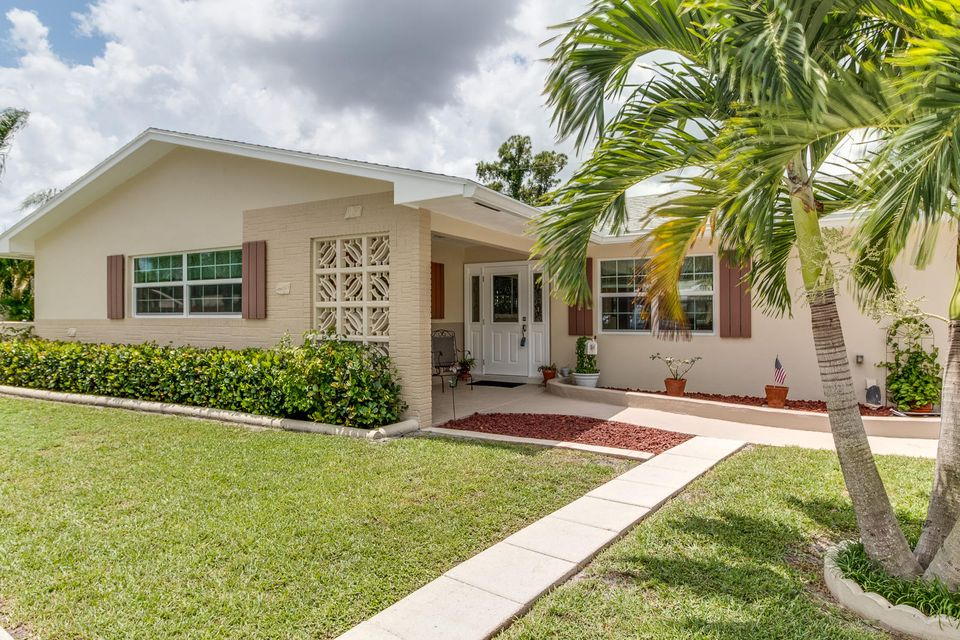 91 W Mango Road , Lake Worth FL 33467 is listed for sale as MLS Listing RX-10241256 27 photos