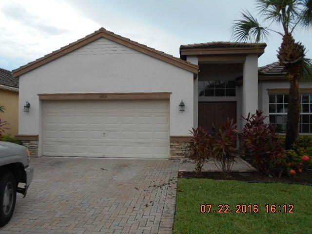 Home for sale in THOROUGHBRED LAKE ESTATES 1 Lake Worth Florida