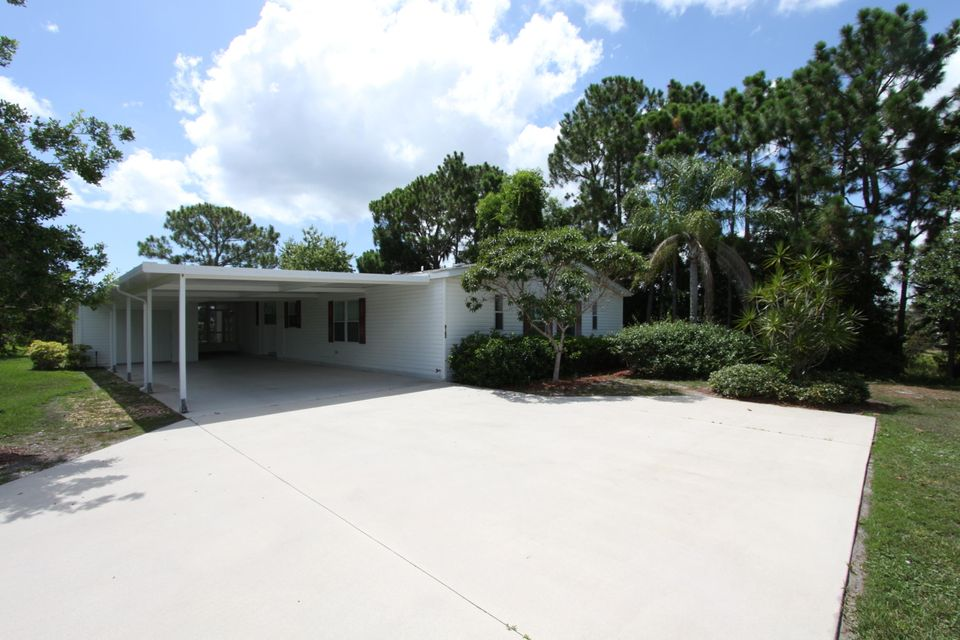 8162 14th Hole Drive , Port Saint Lucie FL 34952 is listed for sale as MLS Listing RX-10259604 27 photos