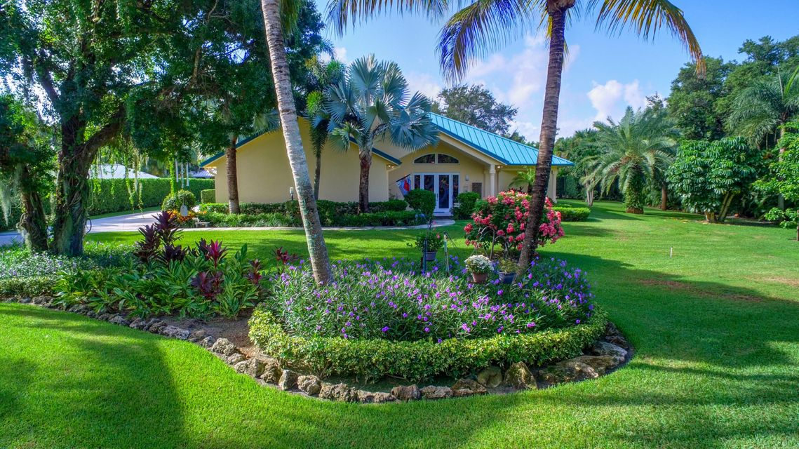 2465 Cardinal Lane , Palm Beach Gardens FL 33410 is listed for sale as MLS Listing RX-10469861 25 photos