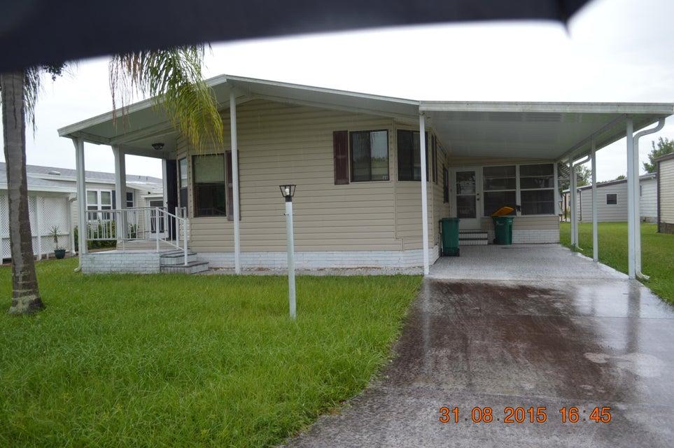 561 Dolphin Circle, Barefoot Bay, FL 32976