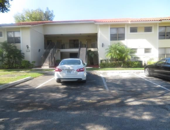 1401 Windorah Way C , West Palm Beach FL 33411 is listed for sale as MLS Listing RX-10294628 9 photos