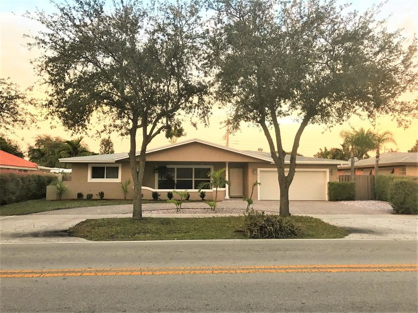 2001 NE 62nd Street is listed as MLS Listing RX-10298022 with 36 pictures