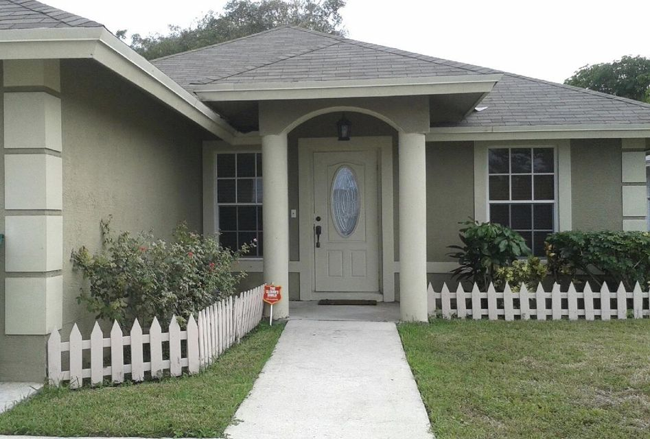 1117 W 35th Street is listed as MLS Listing RX-10297875 with 1 pictures