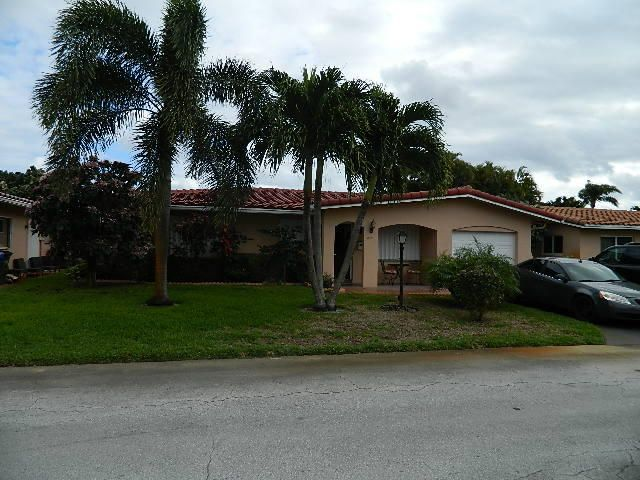 4330 NW 12th Way is listed as MLS Listing RX-10299302 with 17 pictures