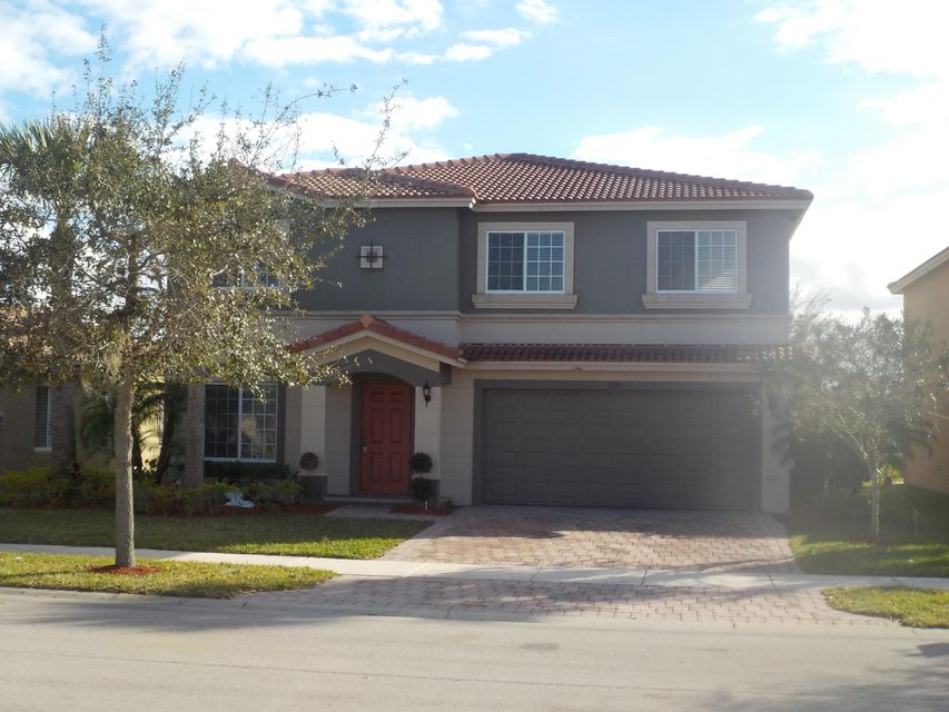 2145 SW Newport Isles Boulevard is listed as MLS Listing RX-10299376 with 8 pictures