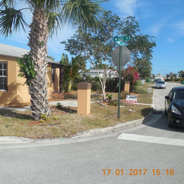 664 W 5th Street is listed as MLS Listing RX-10299639 with 20 pictures