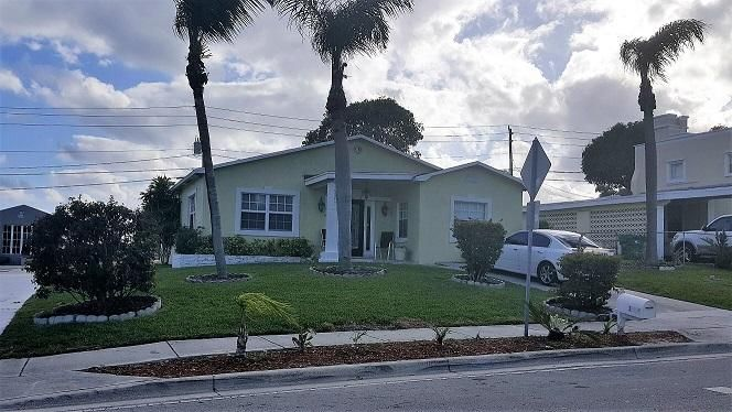 Casa Unifamiliar por un Venta en 1035 W 25th Street 1035 W 25th Street Riviera Beach, Florida 33404 Estados Unidos
