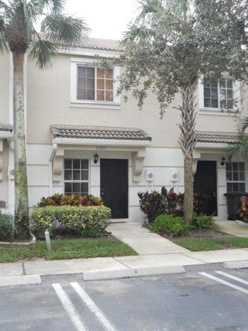 Home for sale in PALMBROOKE TOWNHOMES,JONATHANS COVE West Palm Beach Florida
