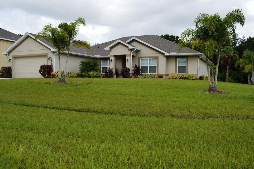 1698 SW Ruiz Terrace is listed as MLS Listing RX-10309660 with 32 pictures