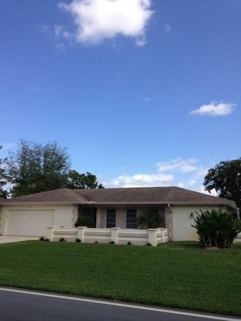 9696  Honeysuckle Avenue is listed as MLS Listing RX-10310259 with 9 pictures