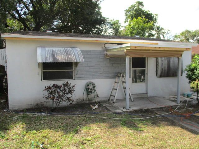 2210 NW 5th Street is listed as MLS Listing RX-10310273 with 8 pictures