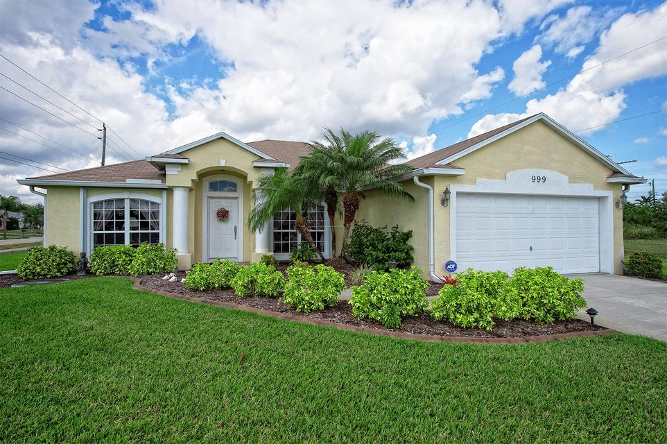 999 SW Butterfly Terrace is listed as MLS Listing RX-10310272 with 31 pictures