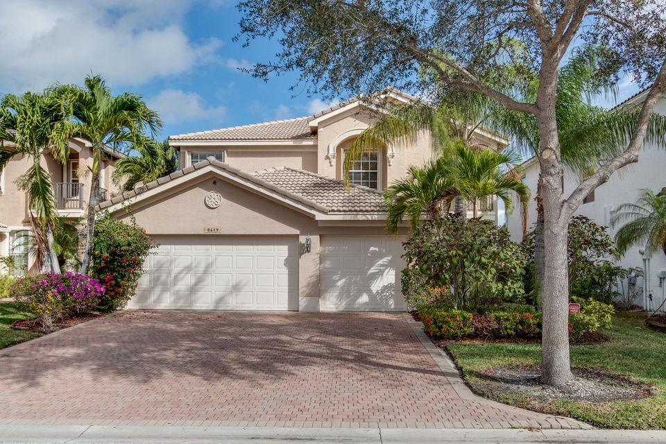 8619  Woodgrove Harbor Lane is listed as MLS Listing RX-10311362 with 63 pictures