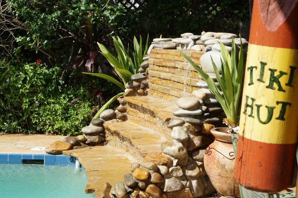 701 Sunshine Dr Waterfall and Tiki_web