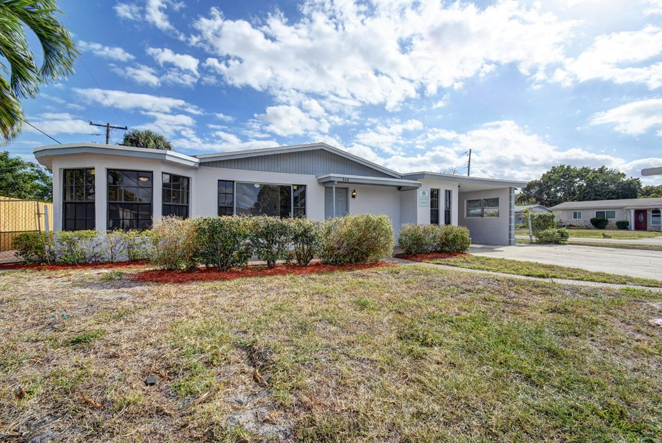 688 NW 20th Street is listed as MLS Listing RX-10318386 with 23 pictures